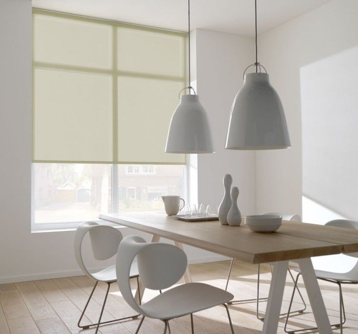 Sheer roller blinds in white diining room, white ceiling pendants | Remodelista