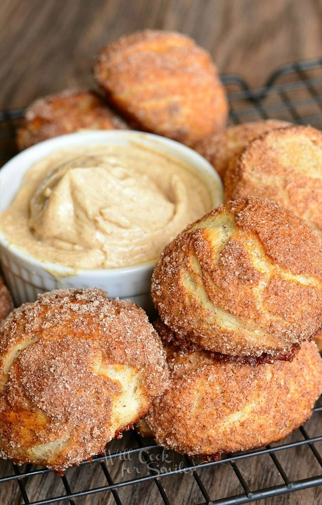 Snickerdoodle Pretzel Puffs. Soft, fluffy little pretzel buns made and coated with cinnamon and sugar and served with creamy cinnamon dip. | from willcookforsmiles.com