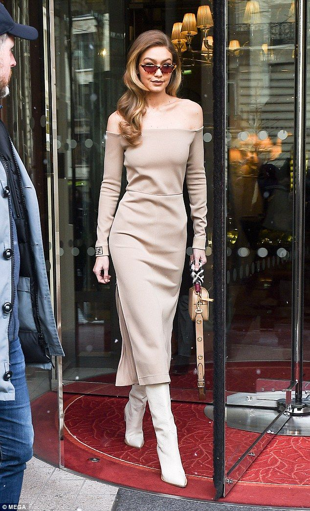Exiting in style: Snow may be falling across Europe, but that didn't stop Gigi Hadid from living up to her fashion icon status on Tuesday as she exited the Royal Monceau hotel in Paris