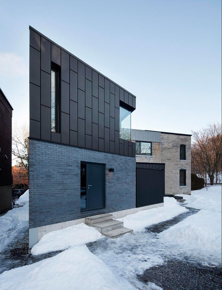 Naturehumaine adds zinc-clad extension to 19th-century home in Montreal