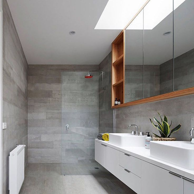 Check out the bathroom in the Trentham Modern Farmhouse by @glowbuildingdesign featured in yesterday's @lunchboxarchitect email. It's amazing that such a simple palette of grey and white can be lifted and warmed with the smallest injection of timber. A skylight washes the room with natural light - just gorgeous. by undercoverarchitect