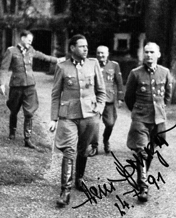 """SS-Sturmbannführer Heinrich """"Hein"""" Springer (Divisionsadjutant 12. SS-Panzer-Division """"Hitlerjugend""""); SS-Brigadeführer Fritz Witt (Kommandeur 12.SS-Panzer-Division """"Hitlerjugend""""); SS-Hauptsturmführer Albert """"Papa"""" Schuch (Kommandeur Stabquartier Adjudantur-Abteilung); dan SS-Sturmbannführer Hubert Meyer (Ia 1. Generalstabsoffizier einer höheren Dienststelle - Leiter der Führungsabteilung)"""