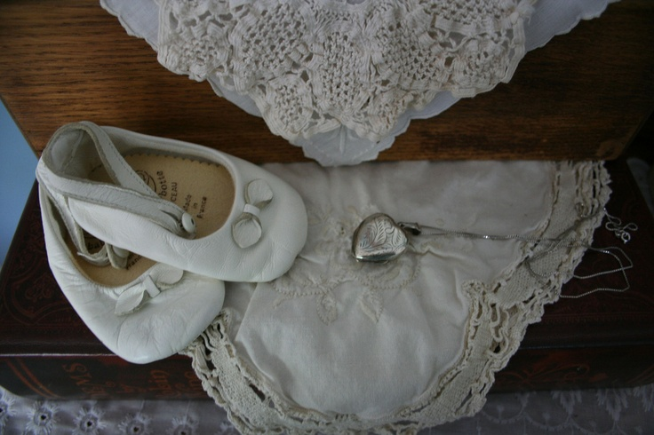 . . . old cherished things passed down through the family. [A daughter's baby shoes, antique doilies and a favorite locket.]