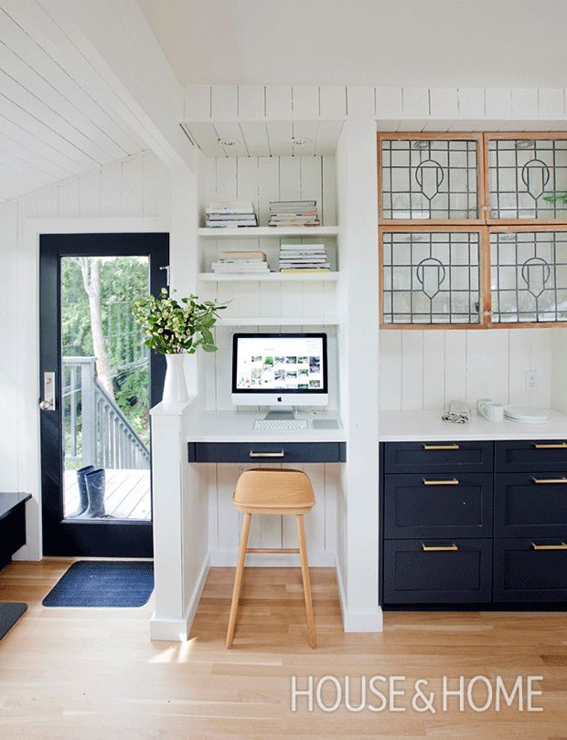 A desktop computer, built-in shelves and a Scandi-inspired stool turn this awkward nook into a handy workspace off the kitchen. | Design: Sophie Burke | Photo: Janis Nicolay