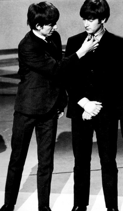 Always joking with each other, George adjusts John's tie as if needed (when…