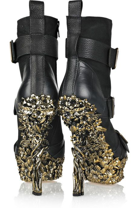 Alexander McQueen is incredible. He thinks of zones, areas of creative expression that are just undeveloped by the history of fashion. How many under-shoes look like this?