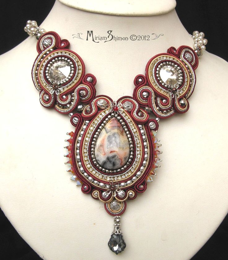 Mangolia Soutache necklace in Silver, Burgundy, Cream with Crazy Agate cabochon. $185.00, via Etsy.