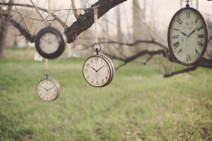 Hanging vintage clocks from trees is such a fun #wedding idea! From http://ruffledblog.com/vintage-time-travel-wedding/  Photo Credit: http://jessicanchristie.com/