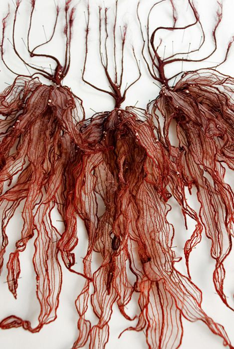 Lorenzo Nanni uses silk and embroidery to create incredibly detailed sculptures of underwater creatures and various forms of botany.