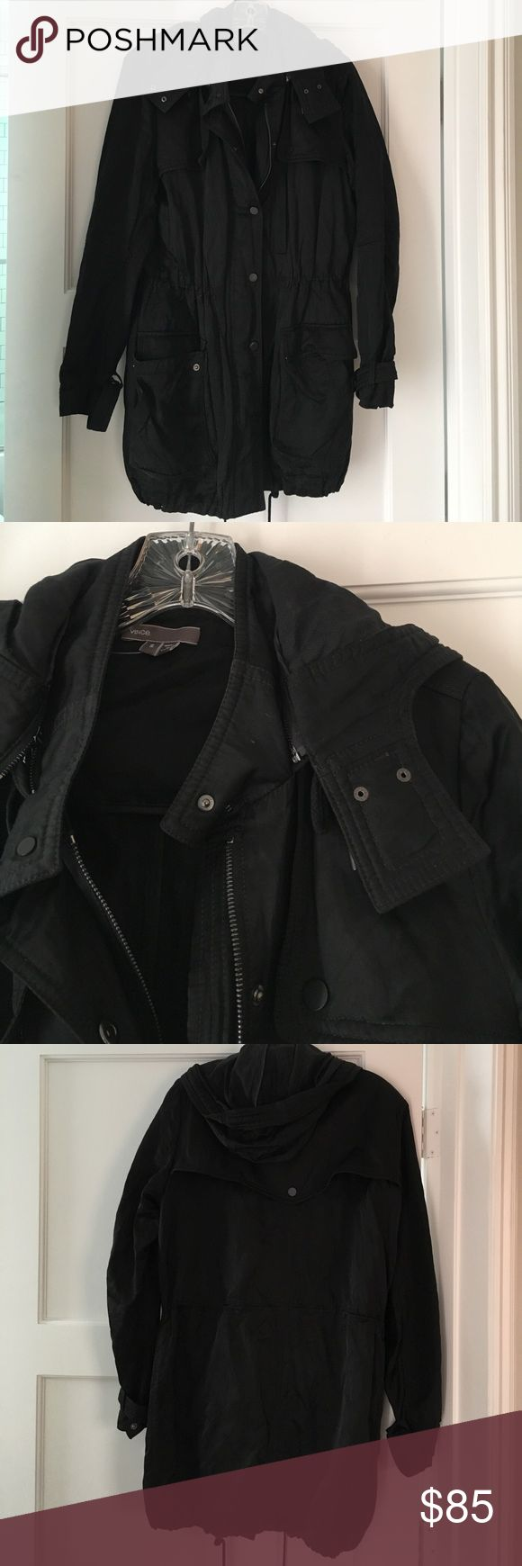 Vince black rain parka Black rain parka by Vince. Long modern fit . Missing a snap closure but it also zips up so not necessary . True to size Vince Jackets & Coats Utility Jackets