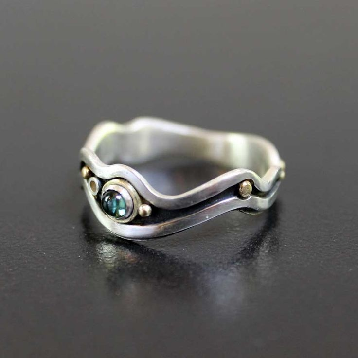 Tourmaline river ring by Abi Cochran  |  This is a unique handmade ring made from sterling silver and 18ct yellow  gold.