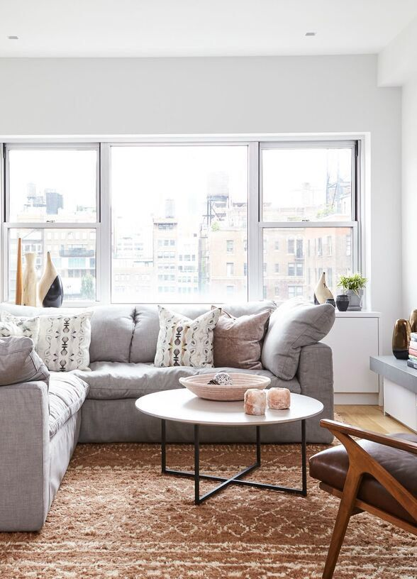 How To Choose A Coffee Table Or Ottoman Plus 15 Favorites Gray Sectional Living Room Eclectic Living Room Small Living Rooms #ottoman #small #living #room