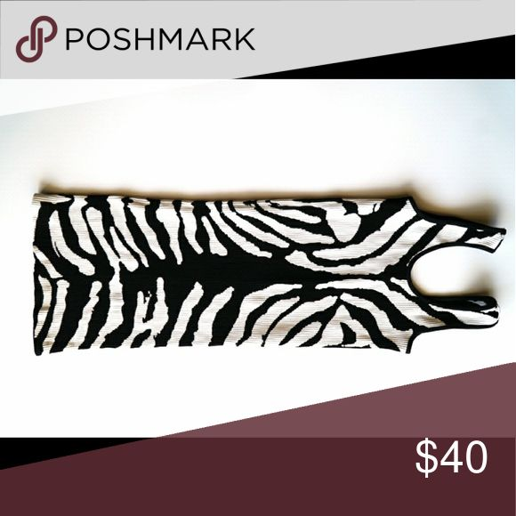 Bebe animal print body con dress Body con dress. Used once. Can stretch to make it thigh high or above the knee. bebe Dresses