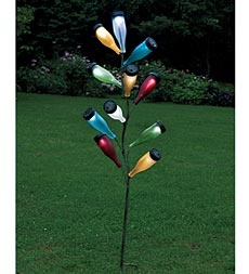 **** I WANT THIS!!!****Metal Bottle Tree Sculpture And Colorful Glass Solar Bottles