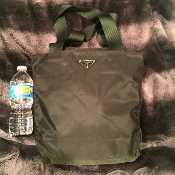 Prada nylon bag Army green beautiful nylon Prada handbag.  Perfect for college campus life/travel/living in the city. Has super sturdy handles and zipper across the top and on the pack.  Has pocket on the inside. Pictures with water bottle are for comparison. Prada Bags Totes