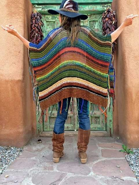 Colorful oversized ruana/poncho. This would be a fun knitting project and a great way to use leftover yarn. I love the fringe side so you don't have to weave in yarn ends...genius!