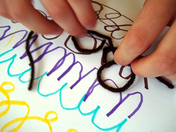 Tactile way of learning cursive. Very arty!