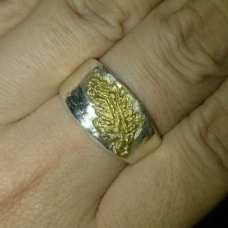 Sierra Santos gorgeous ring, final touch up using Gilder Paste Inca Gold after the ring is dried and filed of course
