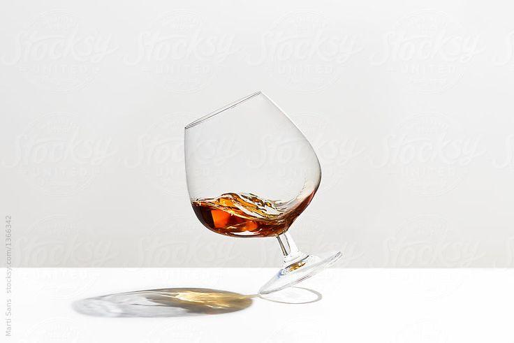 Brandy in falling glass. by Martí Sans for Stocksy United