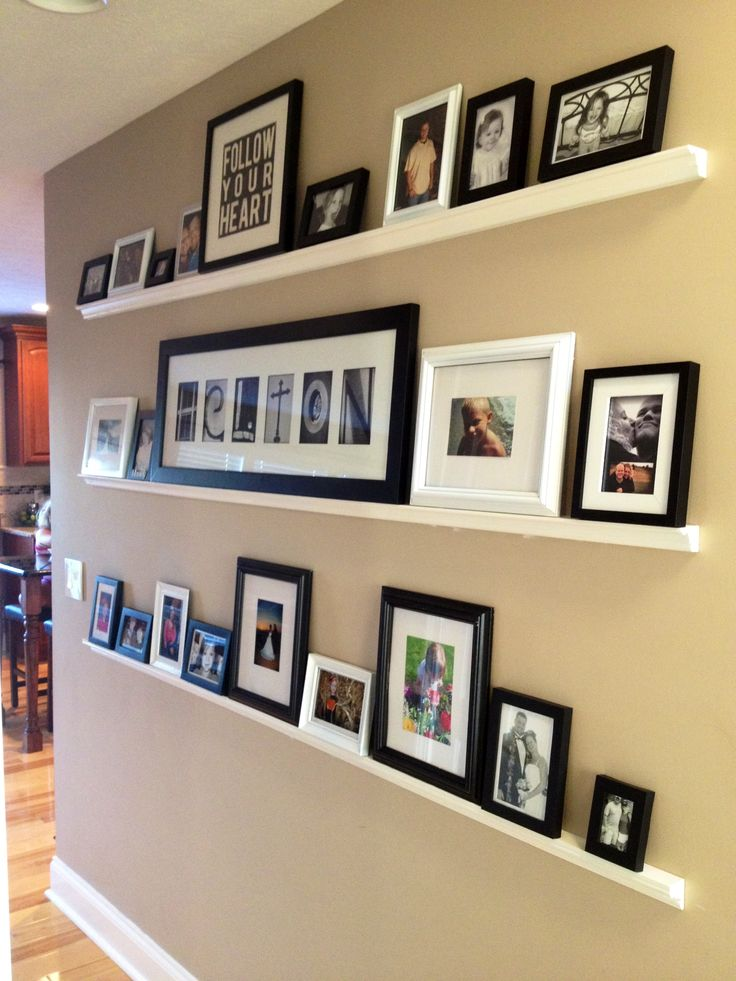 I love the idea of placing photo frames on these skinny shelves. You can constantly change the photo arrangement without unsightly nails in the wall!