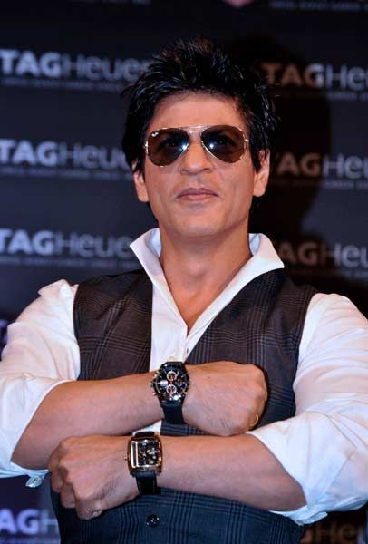 Indian Bollywood film actor Shah Rukh Khan, brand ambassador for TAG Heuer smiles during the launch of the newest Boutique in Mumbai on May 10, 2012.