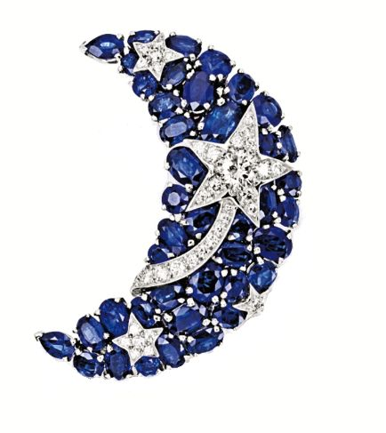 Sapphire and diamond brooch by Chanel. Set with oval sapphires together weighing approximately 11.00 carats, highlighted by a shooting star set with brilliant-cut diamonds together weighing approximately 1.40 carats, mounted in 18k white gold, with retractable pendant fitting, signed and numbered 14J210.