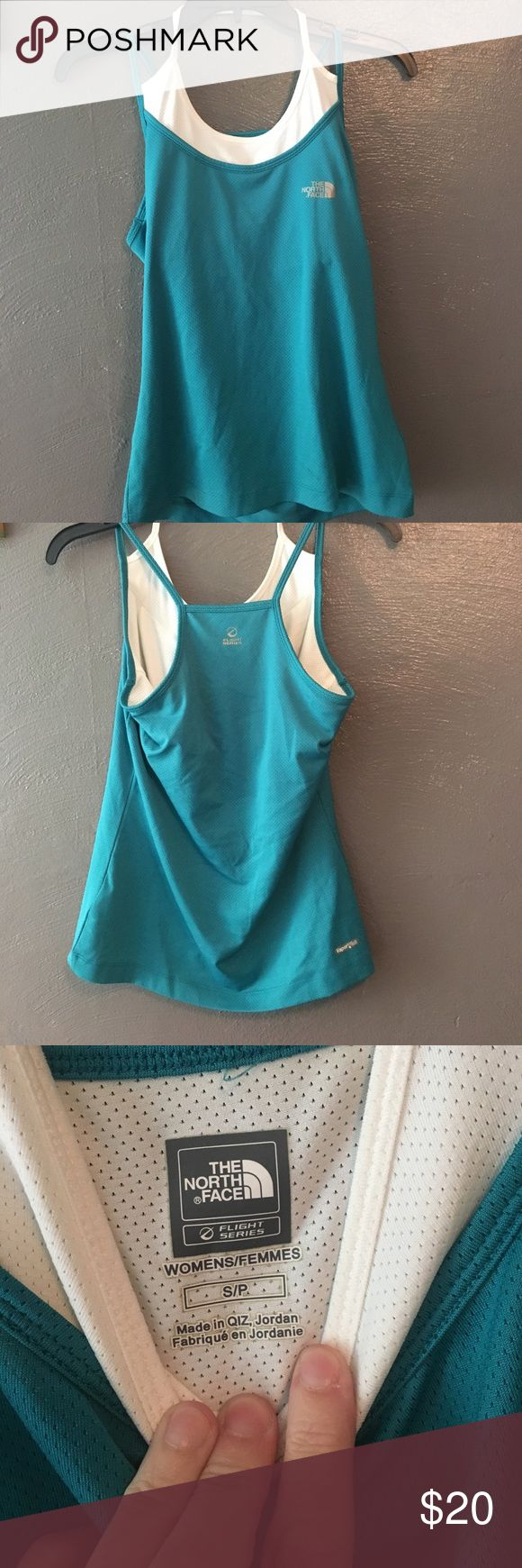 The north face workout top. Cute top. Vapor wick. Great for working out or hiking. Built in bra. Excellent condition The North Face Tops Tank Tops