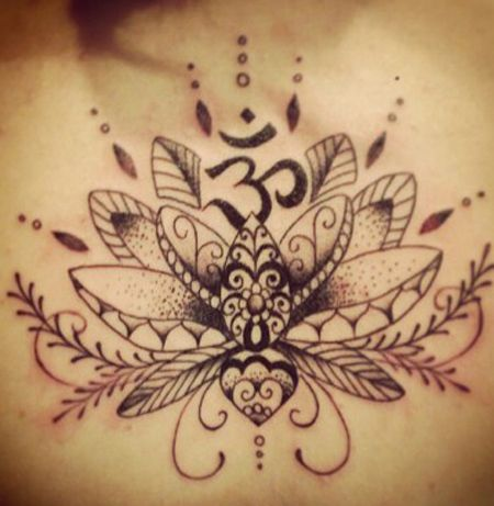 Lotus with Aum Tattoo -I like the om symbol embedded into flower. diff detail than others