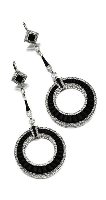 PAIR OF ONYX AND DIAMOND EARRINGS.  Designed as hoops set with calibré-cut onyxes within borders of rose-cut diamonds, supported by delicate fringes and diamond-shaped links similarly decorated, mounted in platinum. Art Deco or Art Deco style.