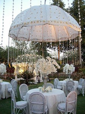 Hang crystals from umbrellas to create a gorgeous vintage feel. #wedding #DIY