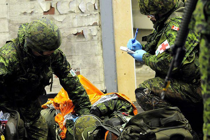Des soldats de 36 Territorial Battalion Group (36 TBG), une composante secondaire de 36 Canadian Brigade Group (36 CBG), effectue l'entraînement d'opérations urbaines dans la municipalité régionale d'Halifax du 23 au 25 janvier, 2015 dans le cadre de l'exercice STEEL TITAN 2015. Photo par : Adj Jerry Kean, Affaires publiques 5e division