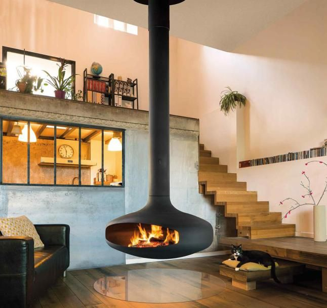 LOVE the hanging fireplace and that cat bed!!! Haha!