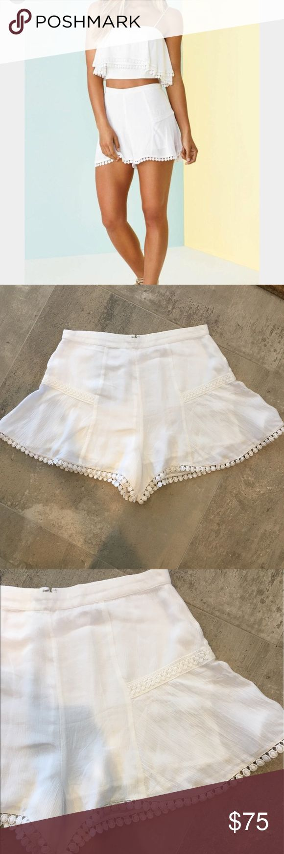 """Lovers + Friends 'Oasis' shorts High waisted shorts, lined. Pom Pom detailing on hem. 12"""" in length. Never worn and so cute!! Lovers + Friends Shorts"""