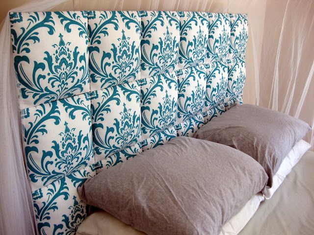 A homemade upholstered headboard. Sounds pretty easy to do! A MUST TRY - a great way to liven up a space.