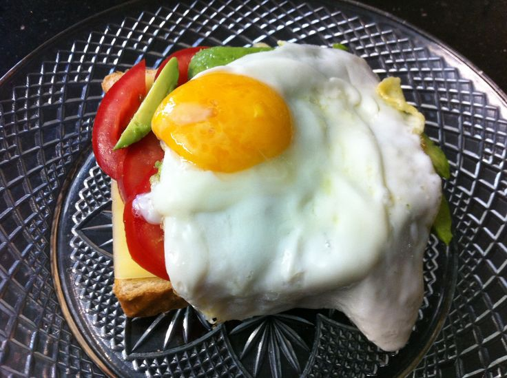 I love egg with avocado and tomato. It is such a good pick me up. Fresh tomato, fresh avocado topped with a runny egg on a pan warmed slice of toast! Perfect!