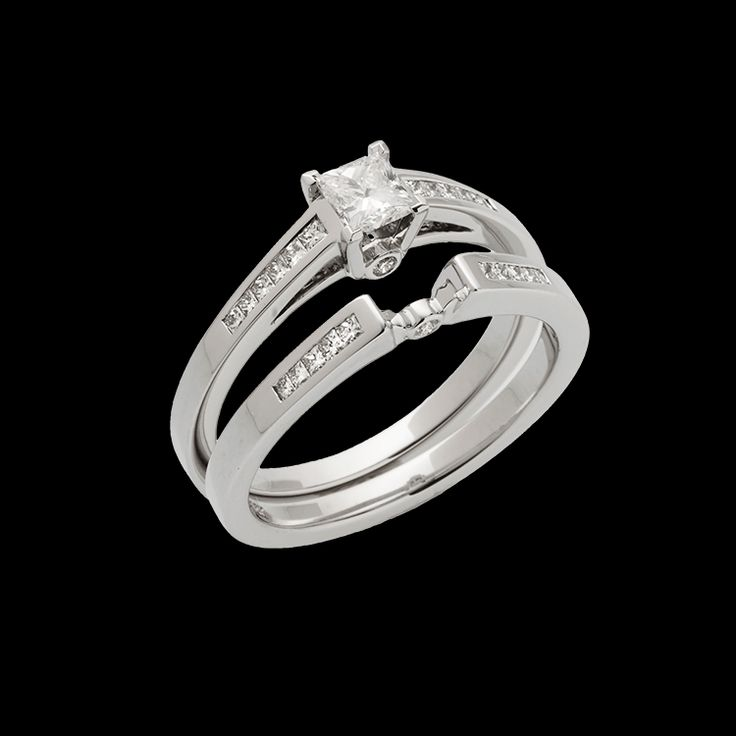 """""""Pandora"""" is flanked with channel-set princess-cut diamonds on each side, This ring has a 0.25 carat princess-cut center diamond."""