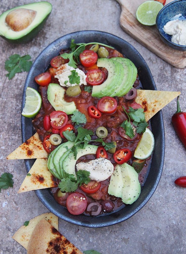 Speedy Lentil and Bean Chilli with Nachos - vegan and gluten free. Super quick but so tasty veggie chilli with delicious toppings and crispy nachos.