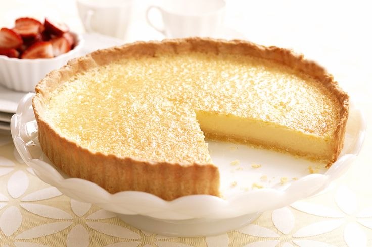 Light, refreshing and tangy, this baked lemon tart is a timeless classic.