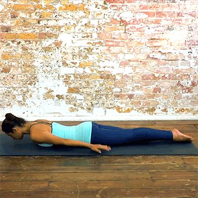 Bhujangasana (Cobra Pose)  Lying on your stomach, engage your back muscles to lift your head and upper torso. Align your elbows underneath your shoulders for support. Open your chest and relax your shoulders away from your ears. Look straight ahead and hold for 1 minute.