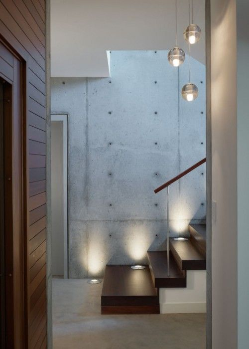 Wooden stairs and concrete walls