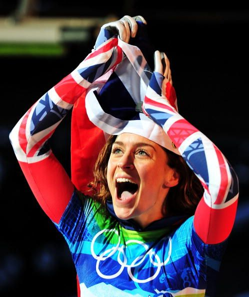 Amy Williams of Great Britain and Northern Ireland celebrates with her countries flag after she won the gold medal in the women's skeleton in the 2010 Vancouver Winter Olympics, 2010.