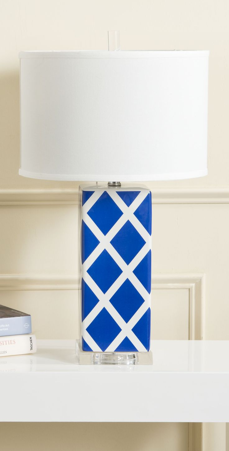 Navy and white ceramic lamp base with white cotton drum shade