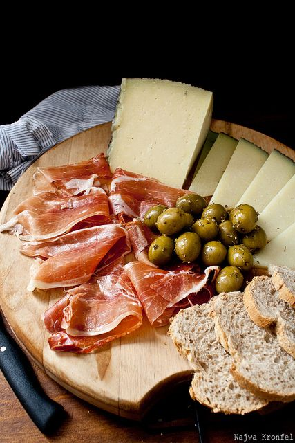 Antipasto tray ...cheeses, olives, prosciutto, and bread....