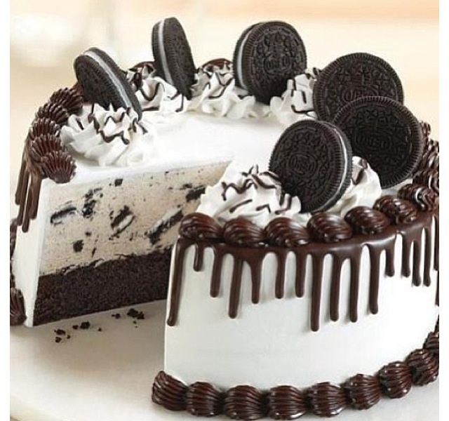 """Cookies and Cream Cake $65 for an 8"""" round that feeds 10-15 people. Vanilla or chocolate cake. Filled with Cookies & Cream Oreo frosting and topped with oreos."""