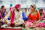 indian-bride-and-groom-talking-smiling-during-sikh-wedding