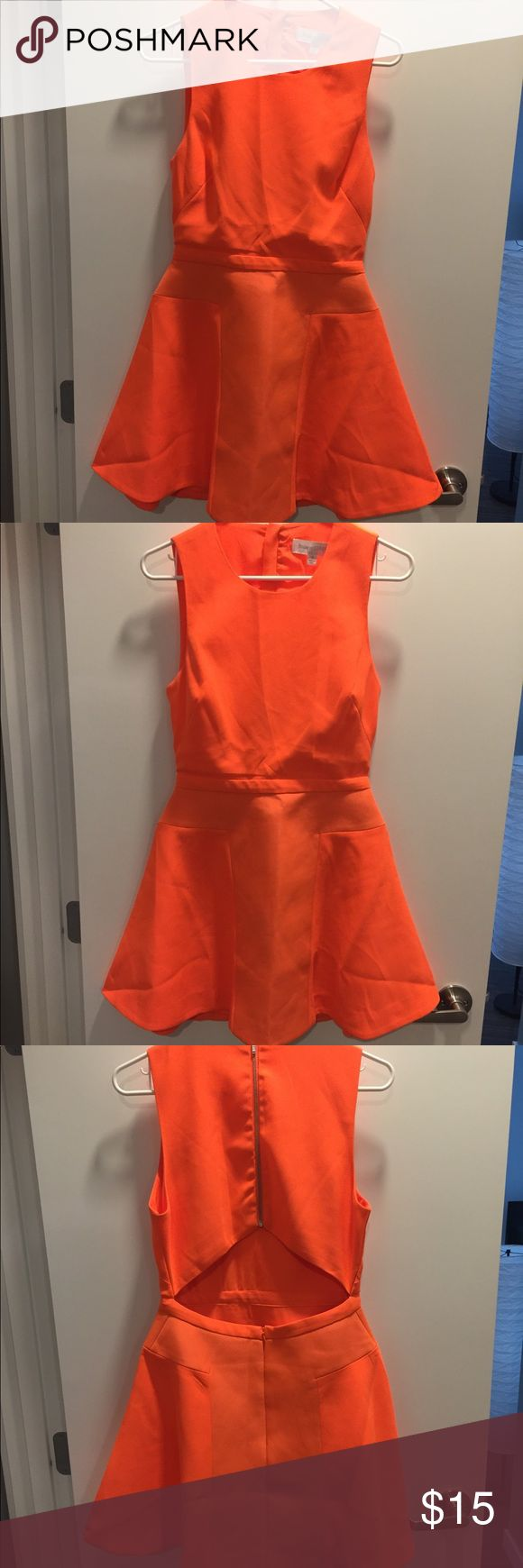 Neon orange mini with back cutout detail Excuse the slight wrinkles, but super cute and fun bright orange party dress! Back has cutout triangle below bra line. Really fun and festive dress! Great for a party or night on the town! Finders Keepers Dresses Mini