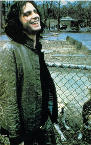 Jim Morrison, a rare smile, this is for you Terri! I'm on my Nook and it wont let me send it to you. But it such a great pic I thought you should have it!