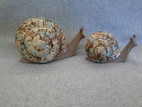 These snails would look great your flower bed or garden. Description from…