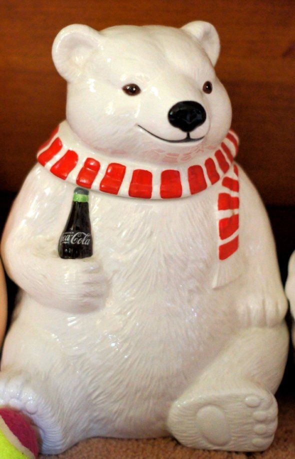 Coca Cola Polar Bear Cookie Jar -- smiling polar bear is wearing his red and white striped scarf and holding a refreshing bottle of coca cola. 1994 by The Coca Cola Company.