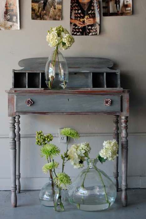 Recycled bottles and white and  chartreuse bottles with 'shabby chic' painted desk